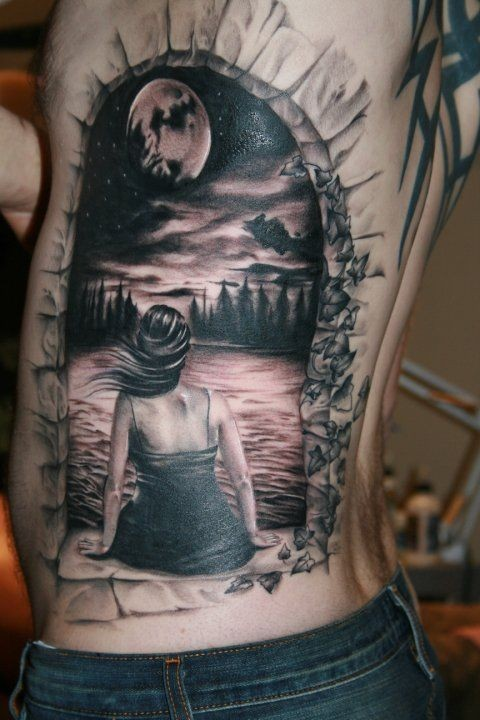Dramatic realistic portrait woman on lake shore with forest and moon tattoo on back