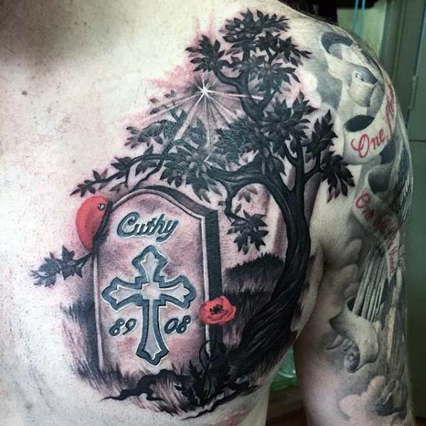 Dramatic themed colored tombstone with lettering and flower on chest