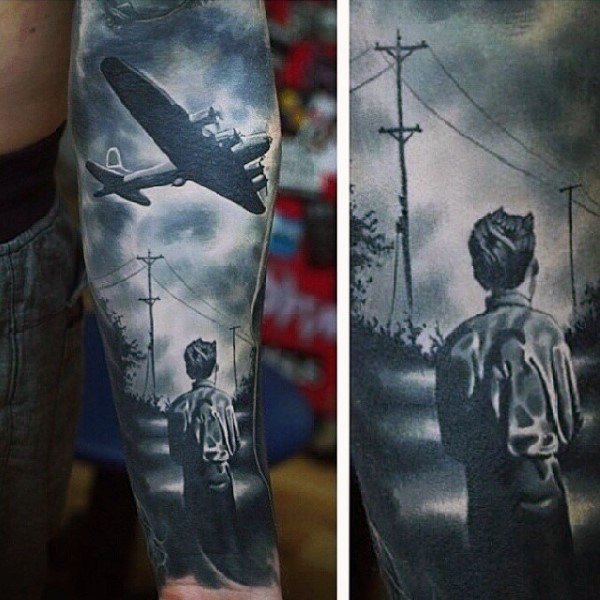 Dramatic WW2 dedicated black and white boy with military plane tattoo on sleeve
