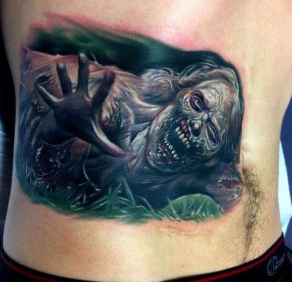 Dreadful creeping zombie tattoo on back