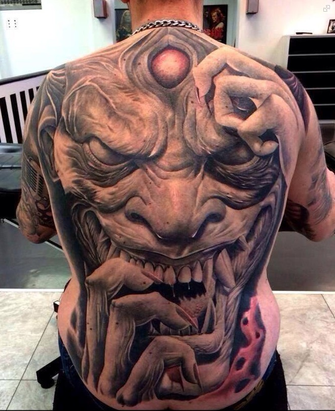 Dreadful japanese demon tattoo on back