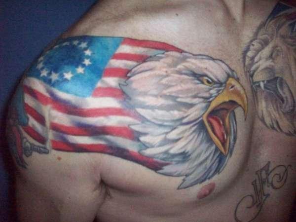 Eagle with usa flag tattoo on shoulder