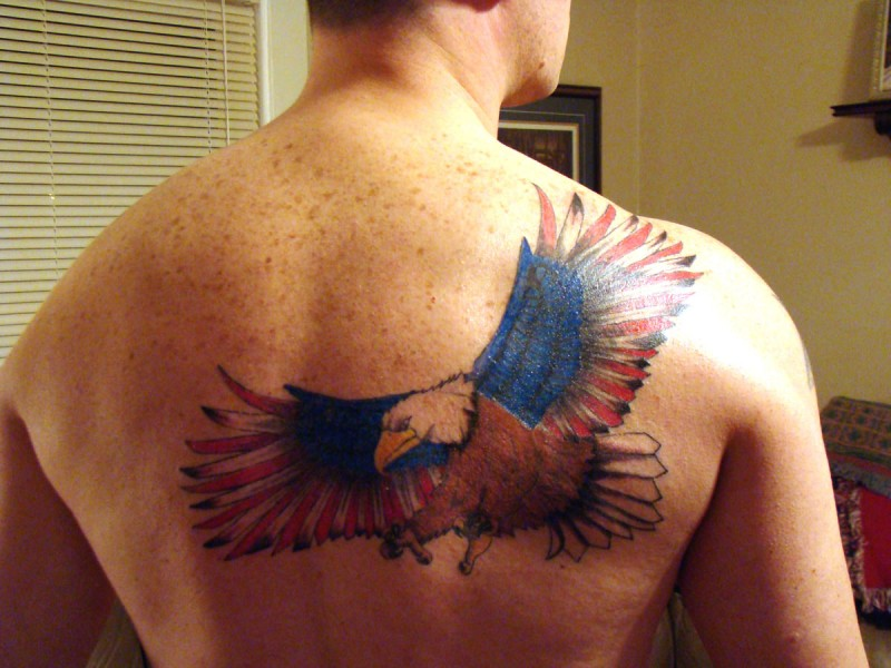 Eagle with usa flag wings tattoo on back