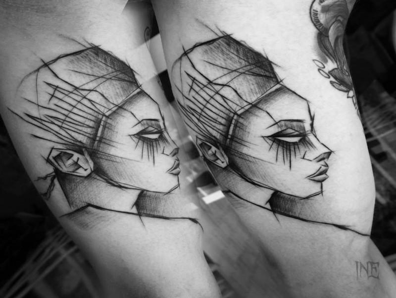 Egypt themed painted by Inez Janiak biceps tattoo of woman portrait
