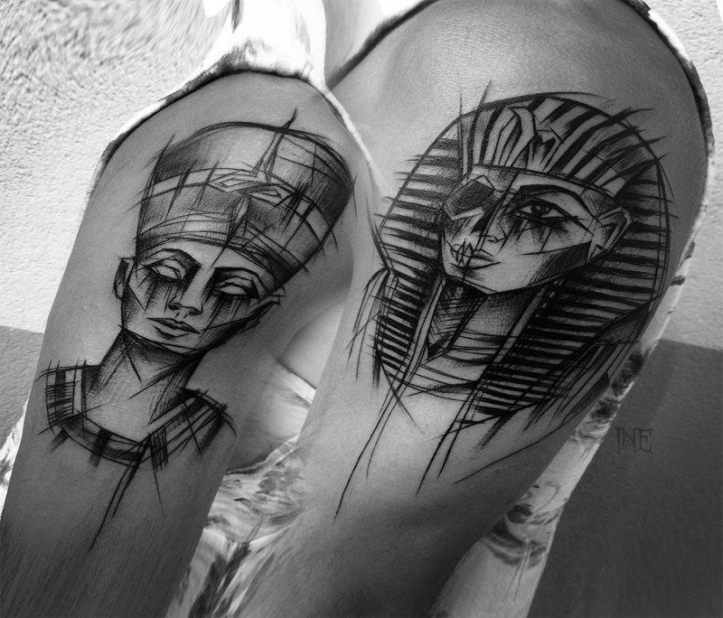Egypt themed painted by Inez Janiak upper arm tattoo of various Pharaoh portraits
