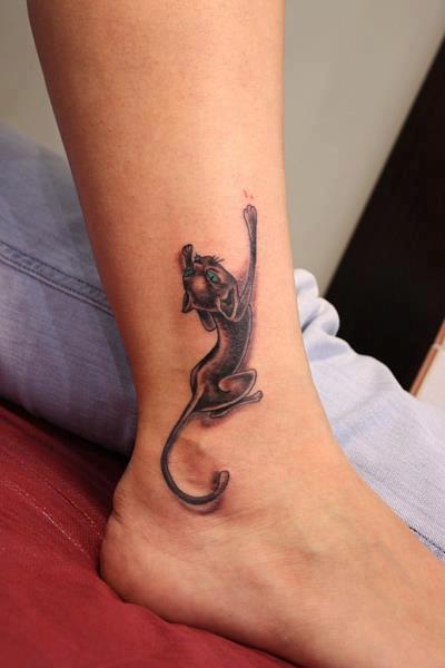 Crawling up cat tattoo on leg