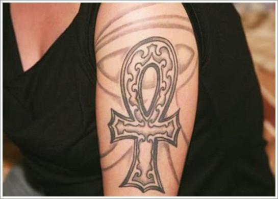 Egyptian cross ankh tattoo on shoulder