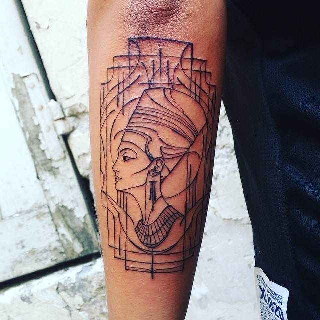 Egyptian Nefertiti black ink tattoo on arm with lined frame
