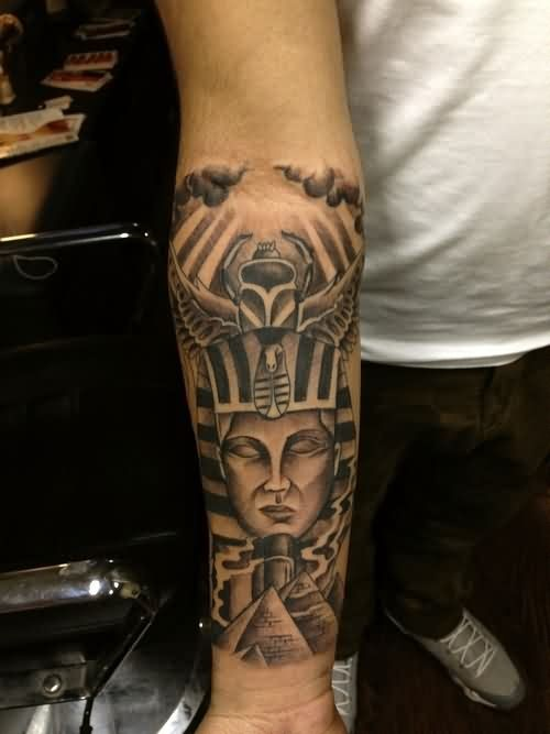 Egyptian Pharaoh Tutankhamen, pyramids and scarab forearm length tattoo