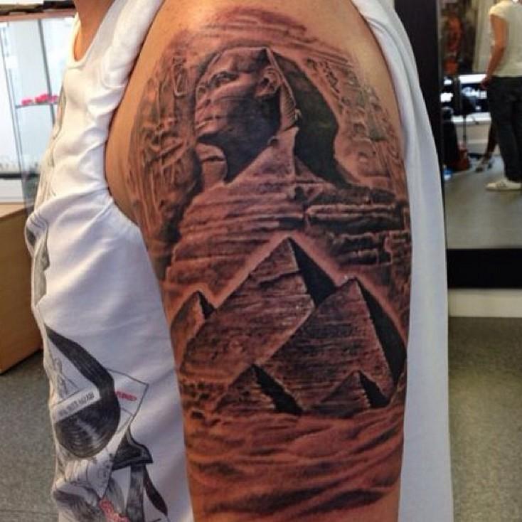 Egyptian pyramids scenery lifelike tattoo on half sleeve area