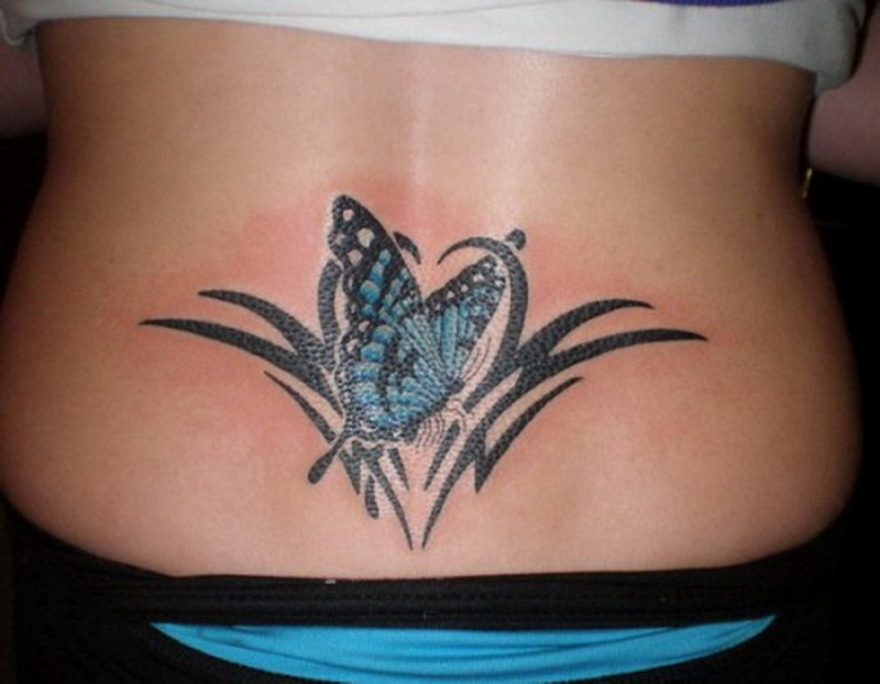 Elegant butterfly tribal tattoo on lower back
