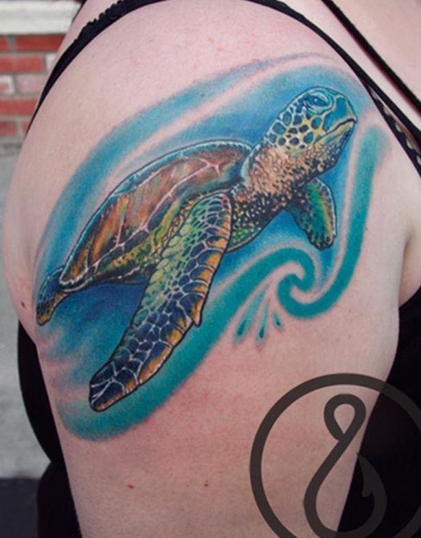 Elegant colorful sea turtle tattoo on shoulder - Tattooimages.biz