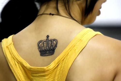 Elegant crown on the back tattoo