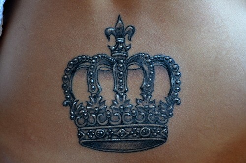 Elegant crown tattoo on belly for girls