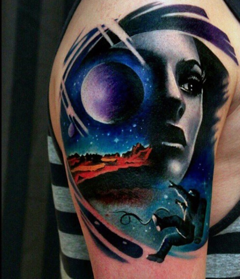 Elegant designed and painted woman with space shoulder tattoo