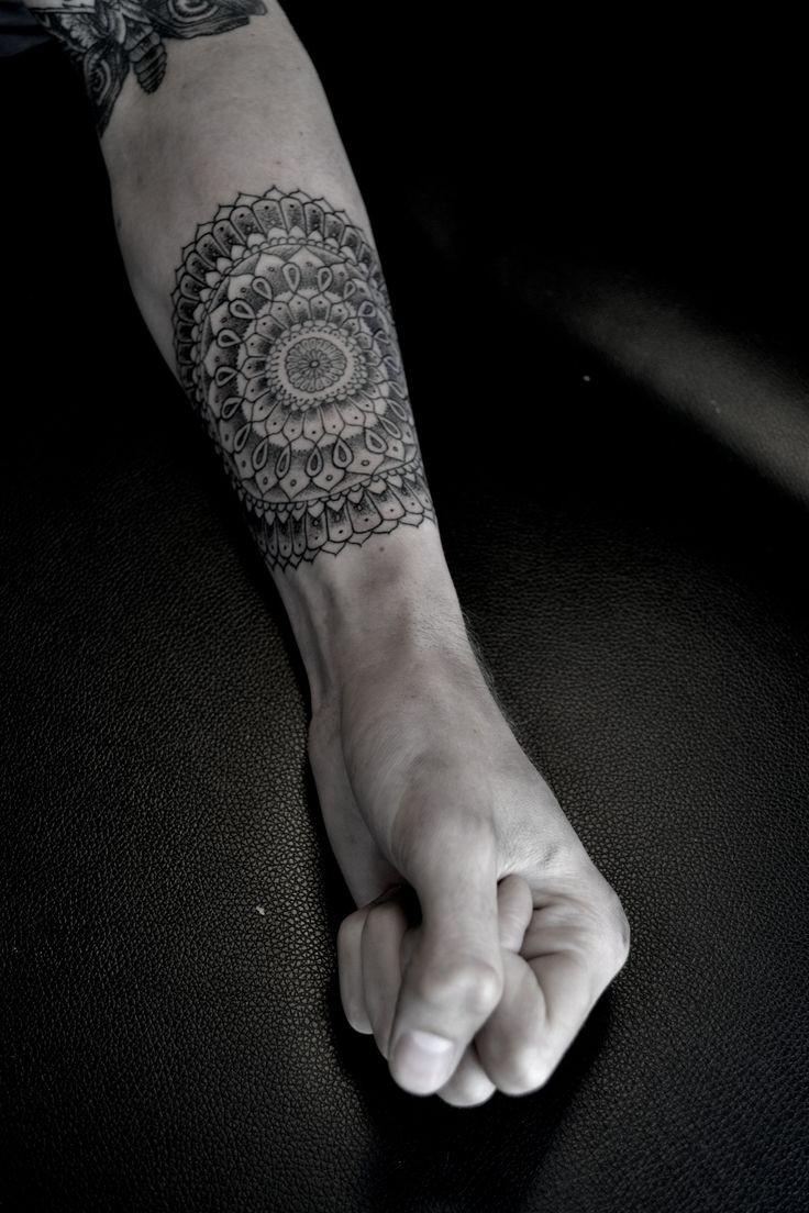 Elegant floral patterns forearm tattoo