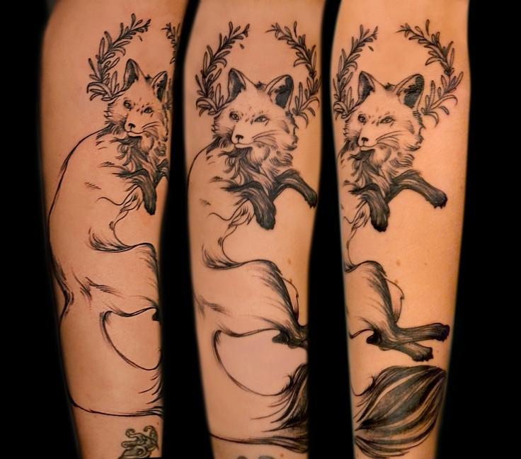 Elegant fox forearm tattoo by Maud Dardeau