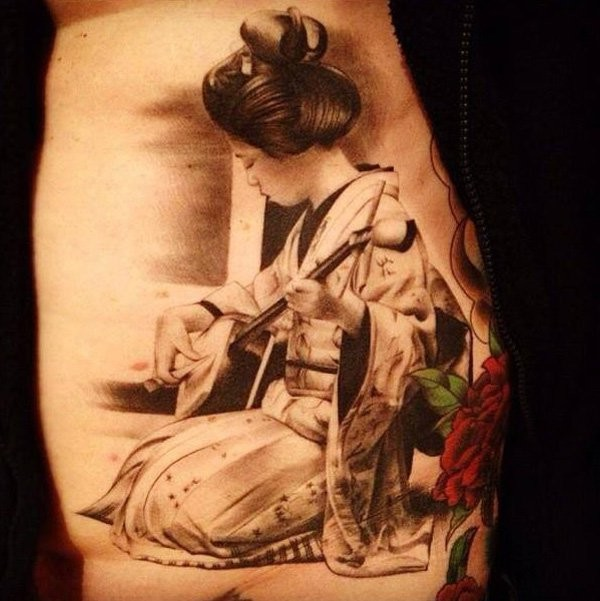 Elegant geisha playing a musical instrument tattoo on back