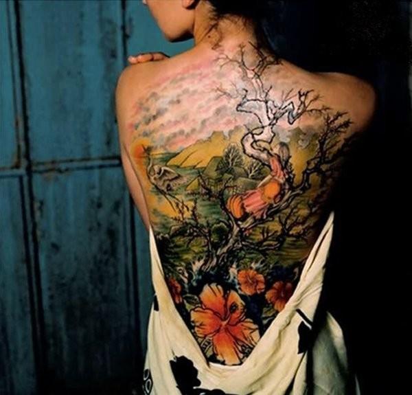 Elegant japanese tattoo on back for women