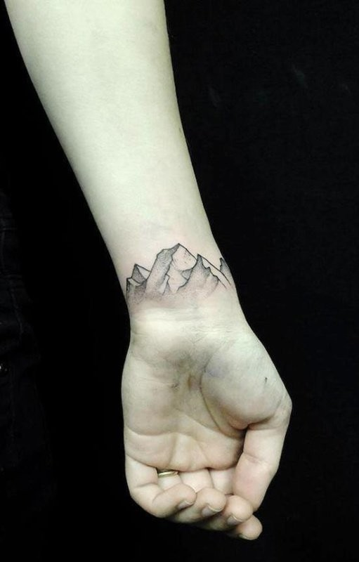 Elegant mountains tattoo on wrist by Jan Mraz