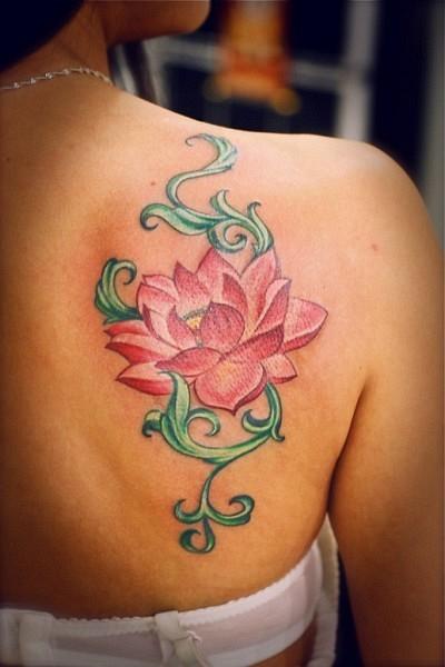 Elegant pink lotus tattoo on back for girls