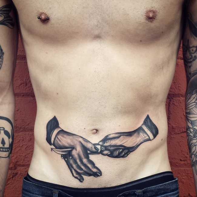 Engraving style black and white belly tattoo of hands with knife