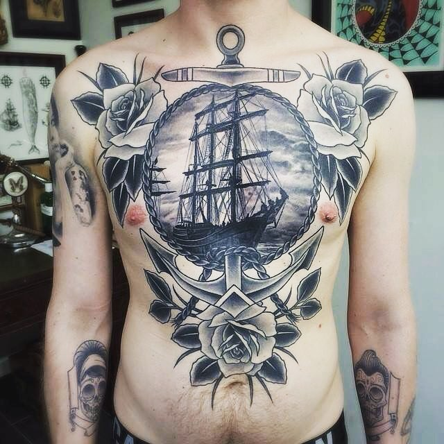 Engraving style black and white chest tattoo of sailing ship with anchor and roses