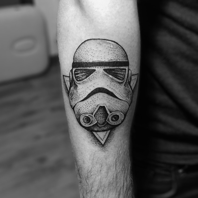 Engraving style black and white forearm tattoo of Storm trooper