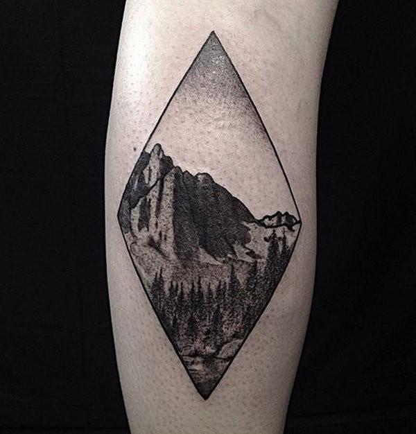 Engraving style black and white leg tattoo of big mountain
