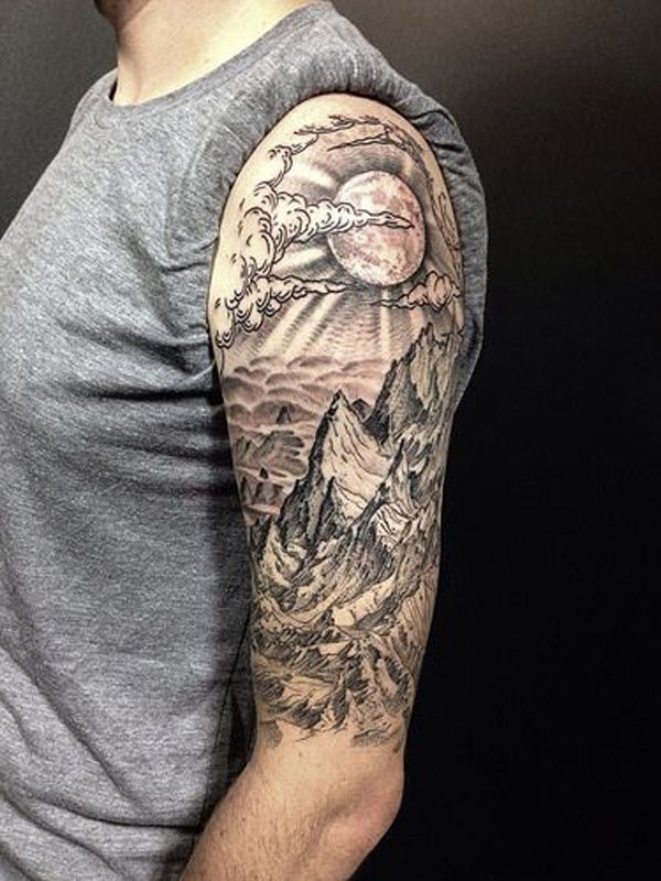 Engraving style black and white shoulder tattoo of mountains with sun