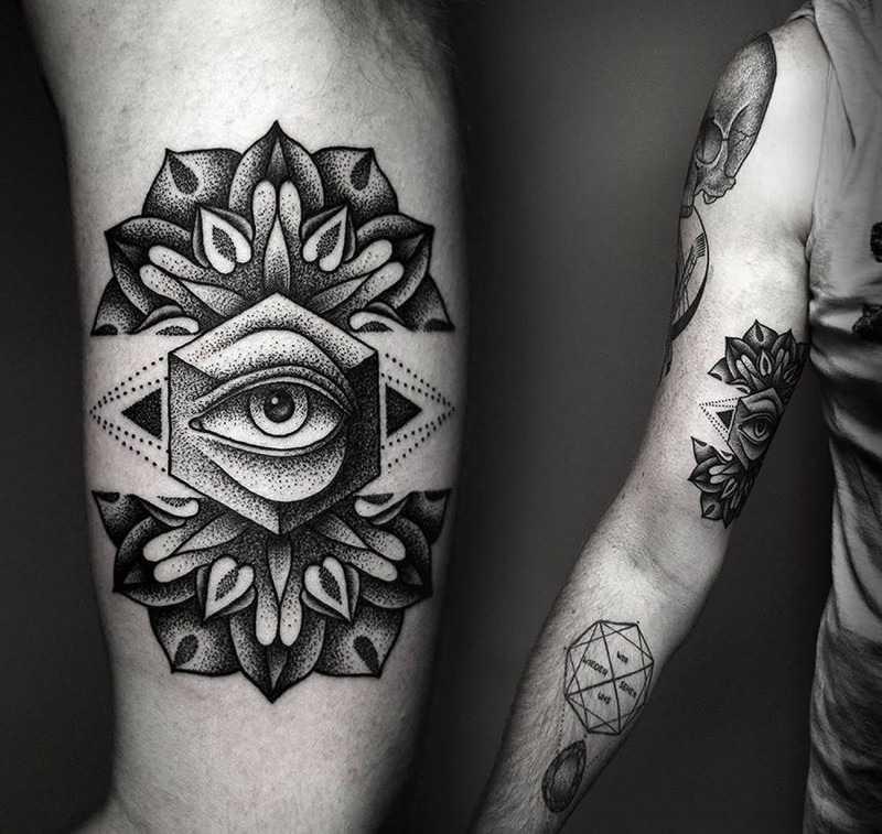 Engraving style black ink arm tattoo of mystical eye with flower