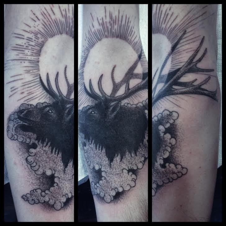 Engraving style black ink arm tattoo of old elk with sun