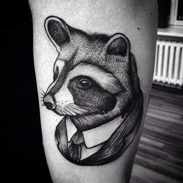Engraving style black ink arm tattoo of raccoon in suit