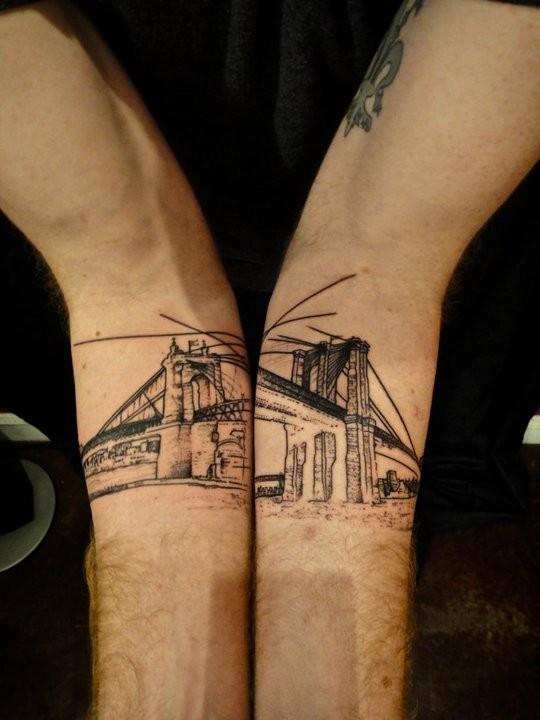 Engraving style black ink arm tattoo of old city bridge