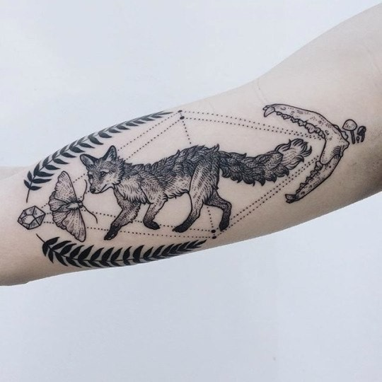 Engraving style black ink arm tattoo of fox with skeleton and butterfly