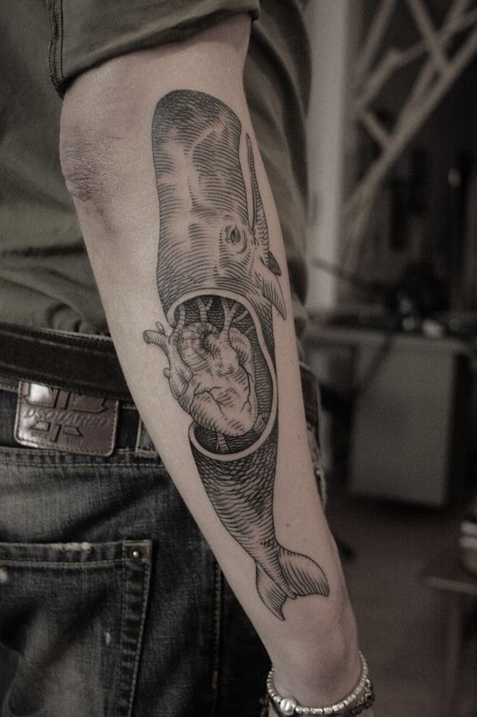 Engraving style black ink arm tattoo of big whale with human heart
