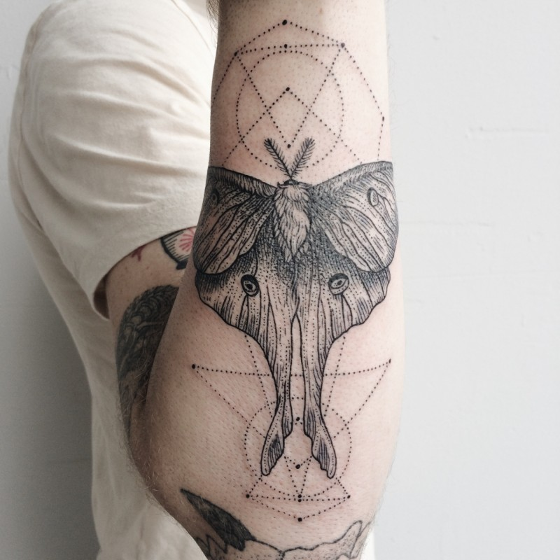 Engraving style black ink arm tattoo of mystical creature with lines