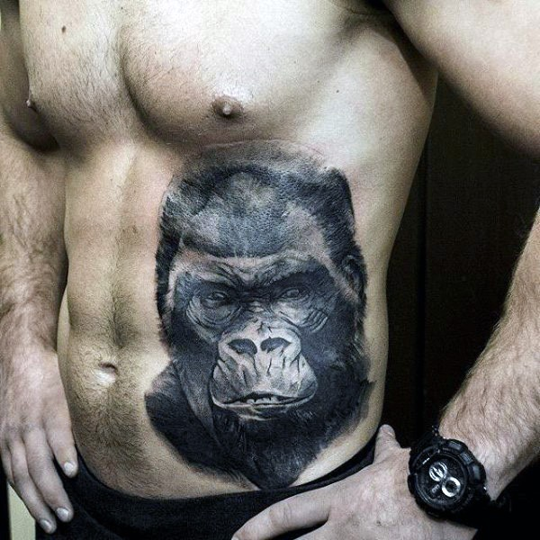 Engraving style black ink belly tattoo of big gorilla head