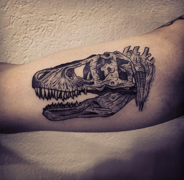 Engraving style black ink biceps tattoo of dinosaur skeleton