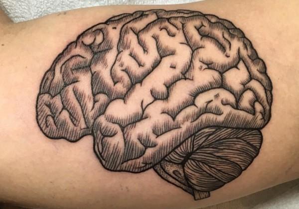 Engraving style black ink biceps tattoo of human brain