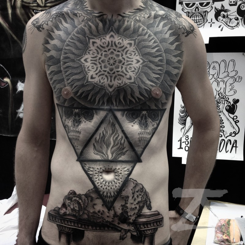 Engraving style black ink chest and belly tattoo of mystical symbols with skull