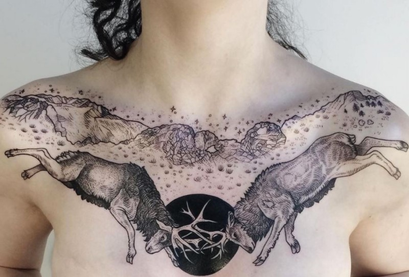 Engraving style black ink chest tattoo of fighting deers and mountains