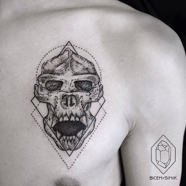 Engraving style black ink chest tattoo of big monkey skull with geometrical figures