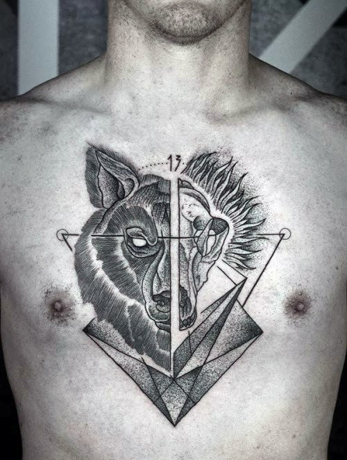 Engraving style black ink chest tattoo of terrifying wolf head with geometrical figures