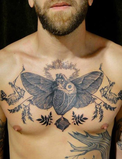 Engraving style black ink chest tattoo of human heart with wings