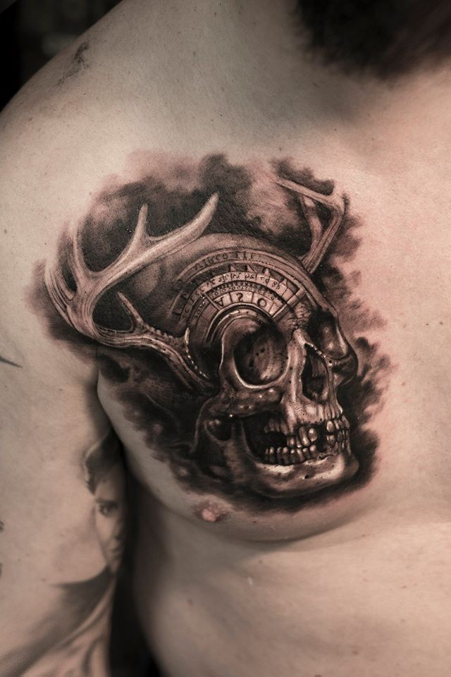 Engraving style black ink chest tattoo of fantasy skull with horns
