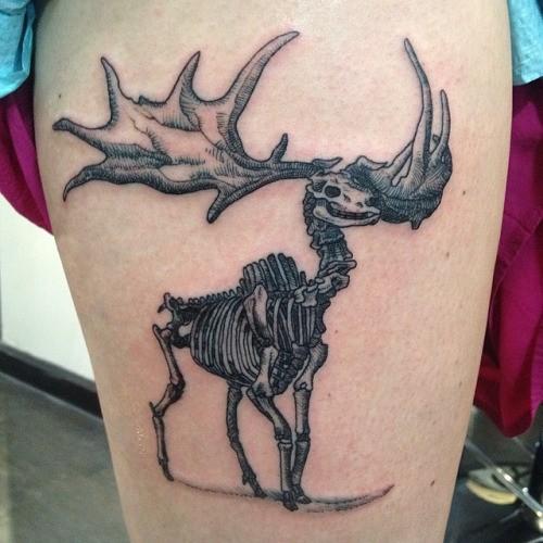 Engraving style black ink deer skeleton tattoo on thigh