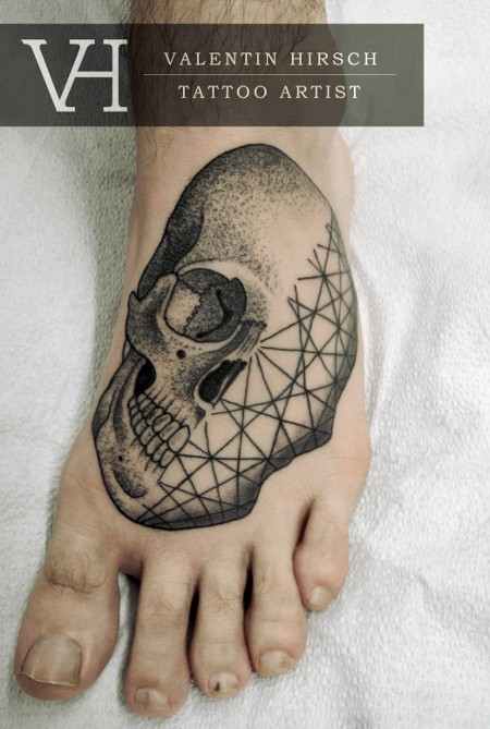 Engraving style black ink foot tattoo of human skull with lines