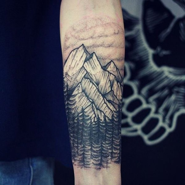 Engraving style black ink forearm tattoo fo mountain forest