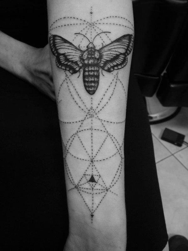 Engraving style black ink forearm tattoo of butterfly with ornaments